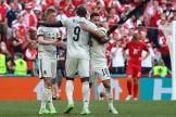 Kevin De Bruyne, Romelu Lukaku et Eden Hazard célèbrent la victoire de la Belgique contre le Danemark.