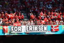 Denmark supporters display a banner for Christian Eriksen, the Danish player who collapsed during the match against Finland last Saturday, June 12, prior to the Euro 2020 soccer championship group B match between Denmark and Belgium, at the Parken stadium in Copenhagen, Thursday, June 17, 2021. (Wolfgang Rattay, Pool via AP)