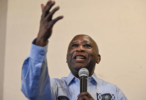Former Ivorian president Laurent Gbagbo gestures as he speaks to supporters at the Ivorian Popular Front (FPI) offices in Abidjan on June 17, 2021. - Ivory Coast's former president Laurent Gbagbo returned home on June 17, 2021 for the first time in a decade after being acquitted by the International Criminal Court (ICC) of crimes against humanity. (Photo by Sia KAMBOU / AFP)