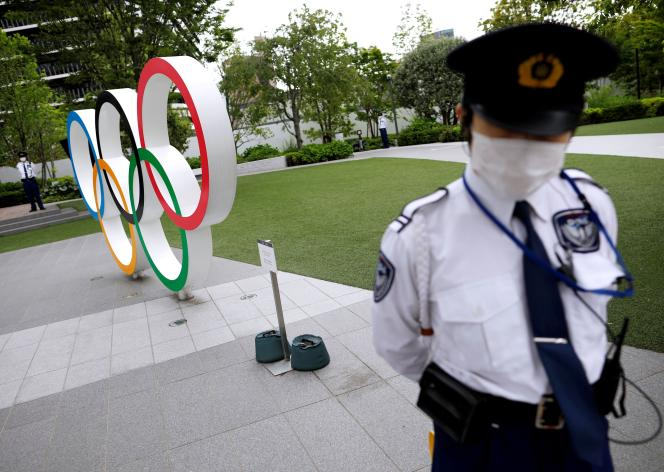 Ahead of the Olympic rings, in Tokyo (Japan), May 18, 2021.