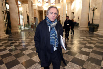 Le Point French news magazine editor in chief Herve Gattegno arrives to attend the trial of the so-called Bettencourt affair, on November 3, 2015 at the Bordeaux's courthouse. Pascal Bonnefoy, former butler of L'Oreal heiress French Liliane Bettencourt, charged with illegaly recording his employer and journalists with publishing the extracts, face charges of breach of privacy starting. AFP PHOTO / MEHDI FEDOUACH (Photo by MEHDI FEDOUACH / AFP)