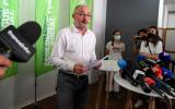 """Jean-Laurent Felizia (C), candidate and head of list of the """"Rassemblement ecologique et social"""" for the regional elections in the Provence-Alpes-Cote d'Azur (PACA) region, delivers a speech during a press conference in Marseille, southern France, on June 21, 2021, to announce his withdrawal before the second round of the election. / AFP / NICOLAS TUCAT"""