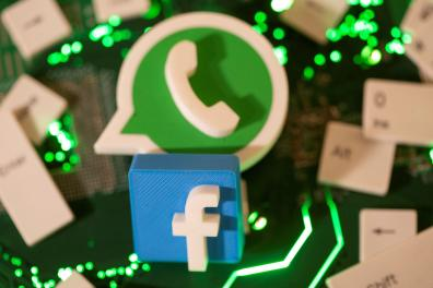 FILE PHOTO: 3D printed Facebook and WhatsApp logos and keyboard buttons are placed on a computer motherboard in this illustration taken January 21, 2021. REUTERS/Dado Ruvic/Illustration//File Photo