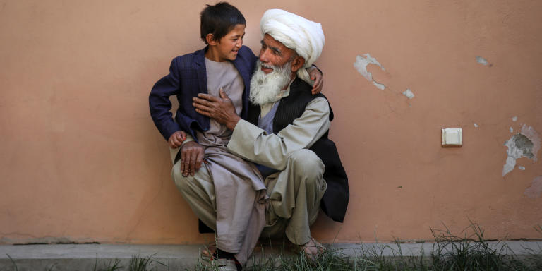 An Afghan boy named Shafiqullah, heart patient, playing with his grand father, Faiz Mohammad, at