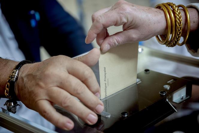Lyon, le 27 juin 2021. Bureau de vote de la salle de la Corbeille, dans le 2e arrondissement de Lyon, pour les élections régionale en Auvergne-Rhône-Alpes.