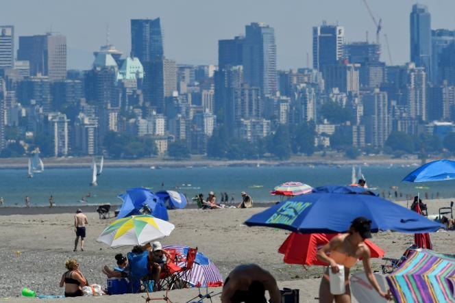 Canadians who want to escape the heat waves, June 27, 2021, come to cool off on the beach in Vancouver, British Columbia.