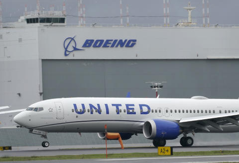 File-This Nov. 18, 2020, file photo shows a Boeing 737 Max 9 built for United Airlines landing at King County International Airport - Boeing Field after a test flight from Moses Lake, Wash., in Seattle. United Airlines is placing a huge order for new planes so it can replace aging ones and prepare for growth as the pandemic subsides. United said Tuesday, June 29, 2021, that it will order 200 Boeing Max jets and 70 Airbus planes. (AP Photo/Ted S. Warren, File)