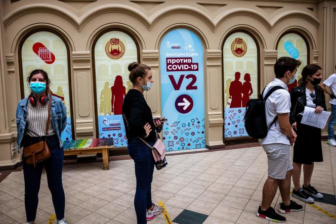 A queue at a shopping center in Moscow to get the Sputnik V vaccine.  Only about 15% of the Russian population has had at least one injection.