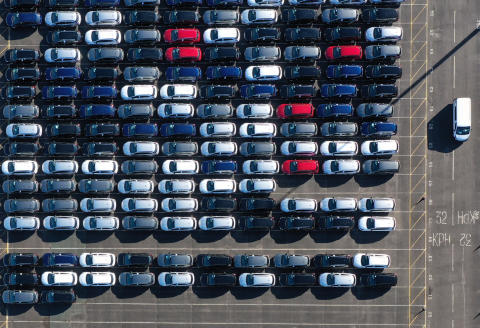 An aerial views shows cars parked up after coming off the production line at the Vauxhall manufacturing plant at Ellesmere Port in north west England on February 22, 2021. (Photo by Paul ELLIS / AFP)