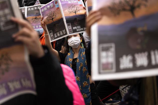 A Piccadilly Circus, à Londres, lors d'une manifestation de solidarité avec le journal hongkongais«Apple Daily»,le 27 juin 2021.