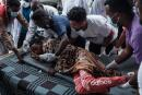 An injured man is moved on a stretcher from an amburance at the Ayder referral hospital in Mekele, on June 24, 2021, two days after a deadly airstrike on a market of Togoga in Ethiopia's war-torn northern Tigray region, where a seven-month-old conflict surged again. At least 64 people were killed and 180 were injured in an air strike on a market in Ethiopia's war-torn northern Tigray region, a local health officer said, as the army denied targeting civilians. / AFP / Yasuyoshi CHIBA