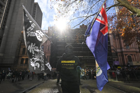 SYDNEY, AUSTRALIA - June 12: Protesters participate in a rally in support of Hong Kong outside of Sydney Town Hall in Sydney, Australia, on June 12, 2021. Sydneysiders will gather outside Sydney Town Hall to show concern for the increasing Chinese influence in Australia and to show support to Hongkongers. The rally takes place on the anniversary of intense confrontation between anti-extradition bill protesters and the Hong Kong Police Force that occurred on 12 June 2019, outside the Government Headquarters in Admiralty, Hong Kong Island. Steven Saphore / Anadolu Agency (Photo by STEVEN SAPHORE / ANADOLU AGENCY / Anadolu Agency via AFP)