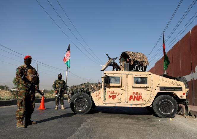 Afghan National Army officers guard a checkpoint in Kabul on July 8, 2021.