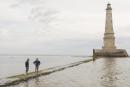 Le Verdon sur mer, vendredi 02 Juillet 2021. SUR LA PHOTO: Les deux gardiens Thomas Dallison (à D) et Pierre Cordier (à G) , seuls sur le peyrat (chemin de pierre) après le départ des derniers visiteurs de la journée. Le phare de Cordouan est situé en mer à 7km de l'embouchure de la Gironde. En service depuis 1611, il est le dernier phrare français à accueillir toute l'année des gardiens. Surnommé le « roi des phares », il sera classé au patrimoine mondial de l'UNESCO en Juillet 2021.