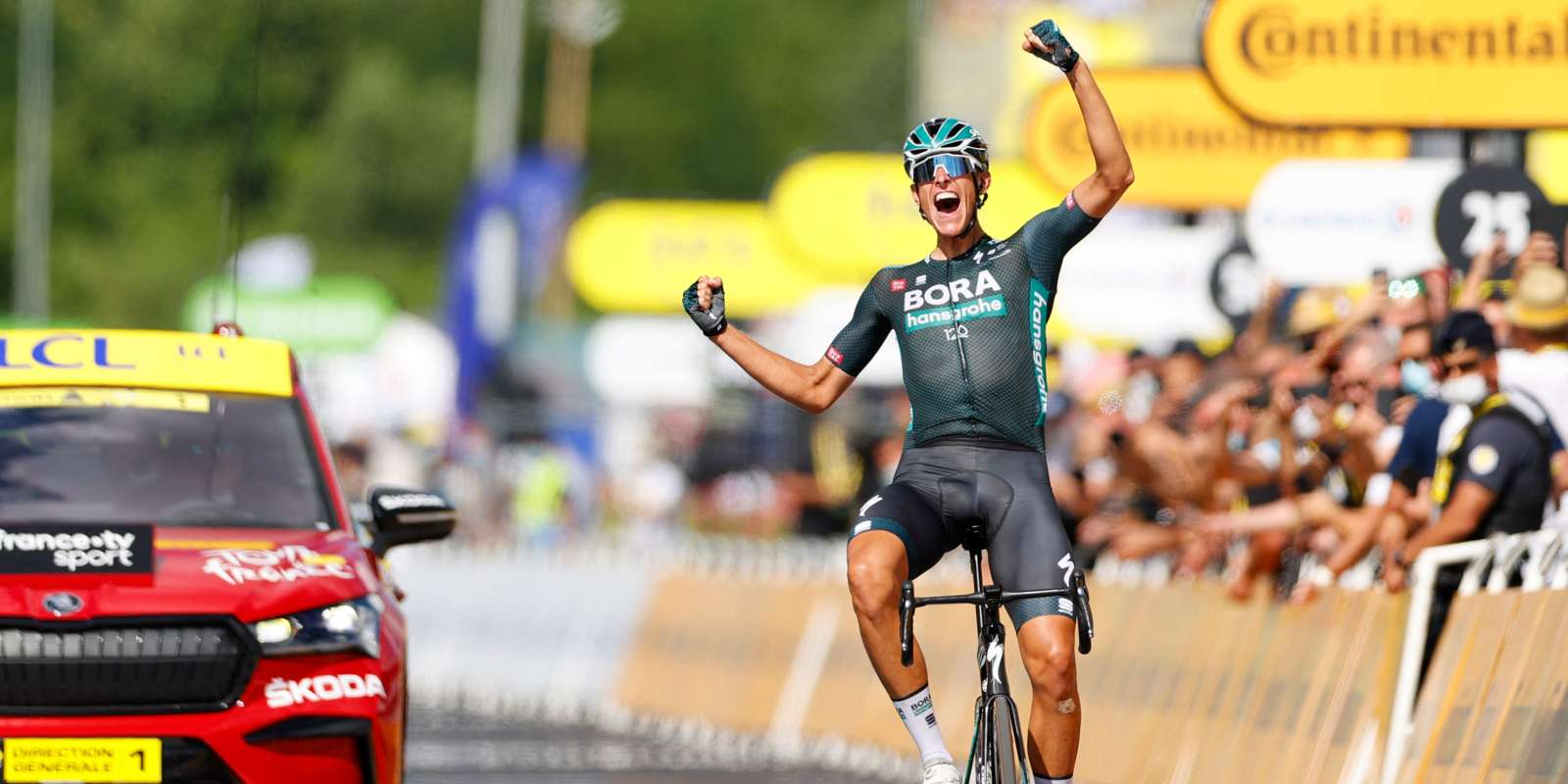 Stage winner Team Bora Hansgrohe's Nils Politt of Germany celebrates as he crosses the finish line at the end of the 12th stage of the 108th edition of the Tour de France cycling race, 159 km between Saint-Paul-Trois-Chateaux and Nimes, on July 8, 2021. / AFP / Thomas SAMSON