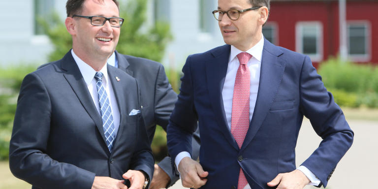 Daniel Obajtek CEO of Polish PKN Orlen oil company and Polish Prime Minister Mateusz Morawieck (R) arrive for a meeting at the Orlen Lietuva Refinery on June 3, 2018 in Mazeikiai, Lithuania. (Photo by Petras Malukas / AFP)