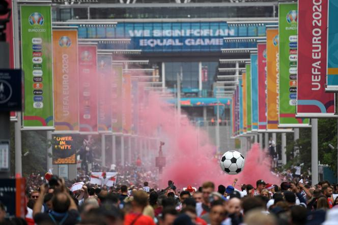 Supporters arrive at Wembley Stadium on July 11, 2021, home to the Euro football final.