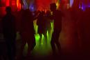 People dance in a nightclub in Saint-Jean-de-Monts, western France, on early July 10, 2021. Nightlife fans across France can once again crowd into clubs starting July 9, 2021, though officials warned they would remain vigilant against any surge in Covid-19 cases in coming days as the more contagious Delta variant of the virus looks set to become the dominant strain in France as soon as this weekend. / AFP / Sebastien SALOM-GOMIS