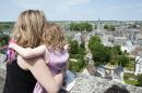 Mother and young daughter looking at view of Vendome, France
