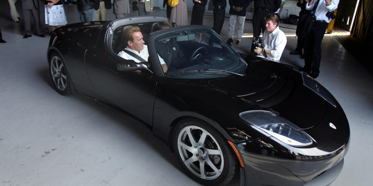 July 19, 2006. Governor Arnold Swartznager took a quick ride in the new Tesla Motors electric roadster. Tesla Motors unveiled its new electric roadster in Santa Monica. Chairman Elon Musk and CEO Martin Eberhard presented the vehicle.  (Photo by Glenn Koenig/Los Angeles Times via Getty Images)