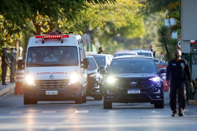Presidential Police with an ambulance carrying Brazilian President Jair Bolzano leave the Armed Forces Hospital in Brasilia, Brazil on July 14, 2021.