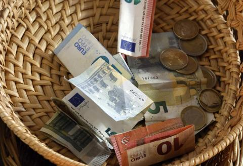 Collection During a Catholic Mass. Basket with Euros. Annecy. France.