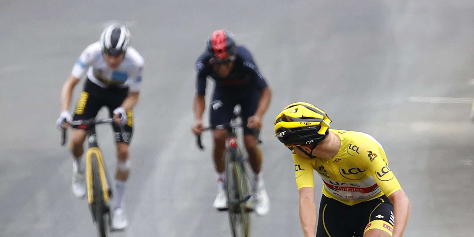 Team UAE Emirates' Tadej Pogacar of Slovenia wearing the overall leader's yellow jersey looks back before crossing the finish line during the 18th stage of the 108th edition of the Tour de France cycling race, 129 km between Pau and Luz Ardiden, on July 15, 2021. / AFP / Thomas SAMSON
