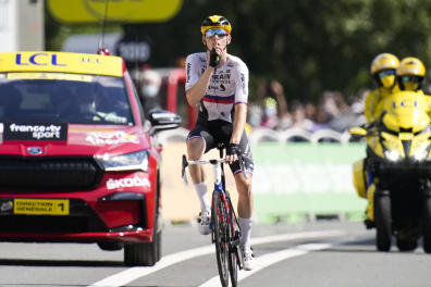 Slovenia's Matej Mohoric gestures to be quiet as he crosses the finish line to win the nineteenth stage of the Tour de France cycling race over 207 kilometers (128.6 miles) with start in Mourenx and finish in Libourne, France,Friday, July 16, 2021. Mohoric's team was subject of a police raid on Wednesday night July 14, 2021. (AP Photo/Christophe Ena)