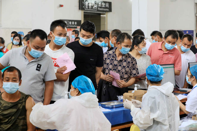 People wait to be vaccinated with Sinovac at a center in Rongan, Guangx region on June 3, 2021.