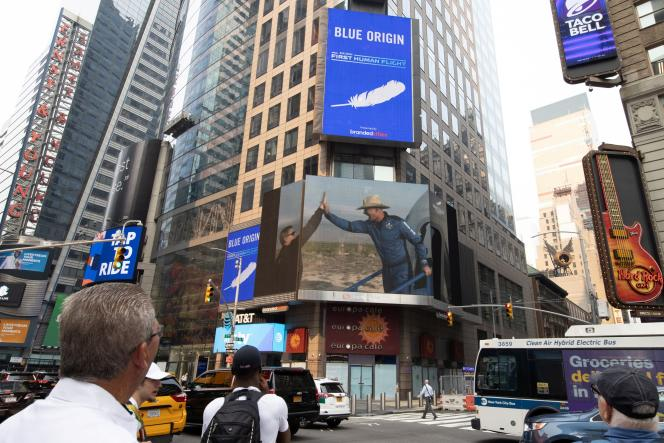 Billionaire Jeff Bezos seen on a screen in Times Square, New York, after Blue Origin's maiden flight landed in the Texas desert on July 20, 2021.