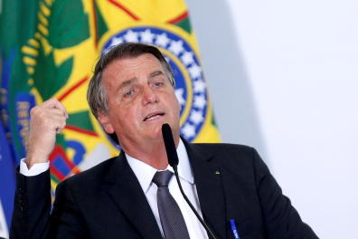 FILE PHOTO: Brazil's President Jair Bolsonaro speaks during a ceremony to sign a law for the privatization of state-controlled electricity utility Eletrobras, at the Planalto Palace in Brasilia, Brazil, July 13, 2021. REUTERS/Adriano Machado/File Photo