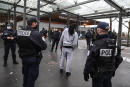 Daily security police officers (Police de la securite du quotidien) control a man at the Garges-Sarcelles train station during a patrol in Garge-les-Gonesse, on February 3, 2021. (Photo by ALAIN JOCARD / AFP)