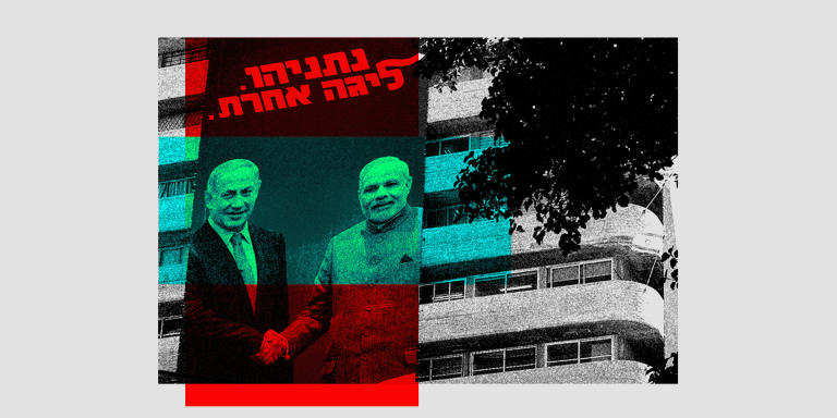This picture taken on July 28, 2019 shows two giant Israeli Likud Party election banners hanging from a building showing Israeli Prime Minister Benjamin Netanyahu shaking hands with Indian Prime Minister Narendra Modi with a caption above reading in Hebrew
