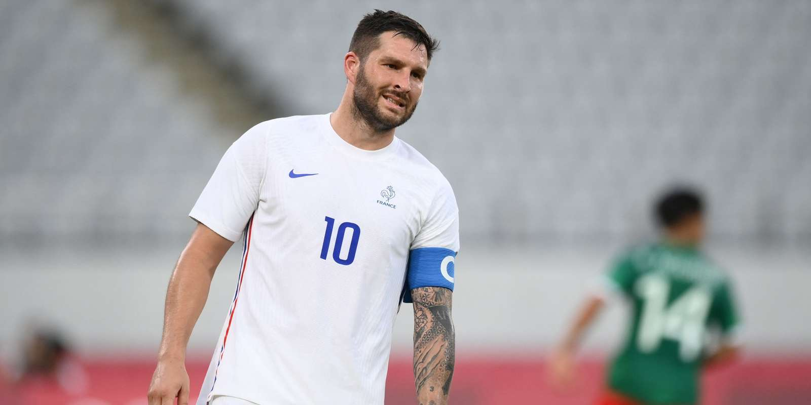France's forward Andre-Pierre Gignac reacts during the Tokyo 2020 Olympic Games men's group A first round football match between Mexico and France at Tokyo Stadium in Tokyo on July 22, 2021. (Photo by FRANCK FIFE / AFP)