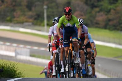 Slovenia's Jan Tratnik leads the second group during the first lap of the Fuji International Speedway in the men's cycling road race of the Tokyo 2020 Olympic Games in Oyama, Japan, on July 24, 2021. (Photo by Greg Baker / AFP)