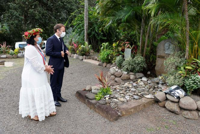 French President Emmanuel Macron and Hiva Oa Mayor Joëlle Frebault in front of singer Jacques Brel's grave in Atuona sur Hiva Oa, French Polynesia, July 25, 2021.
