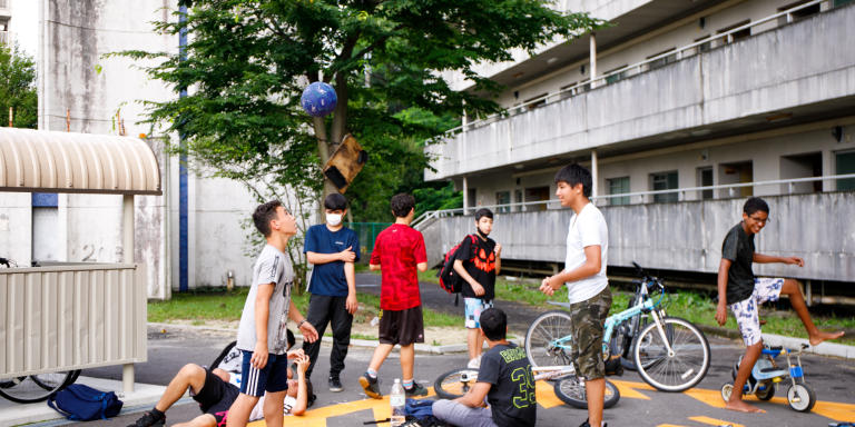 Young residents hanging out at parking in Homi Danchi. There used to be more parks but the prefecture made them into parkings, as more residents have cars these days.  Toyota city in Aichi, Japan on 4th July, 2021. MITSU MAEDA POUR
