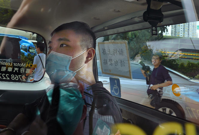 Dong Ying-Kid arrives in court on July 6, 2020 in a police car in Hong Kong.