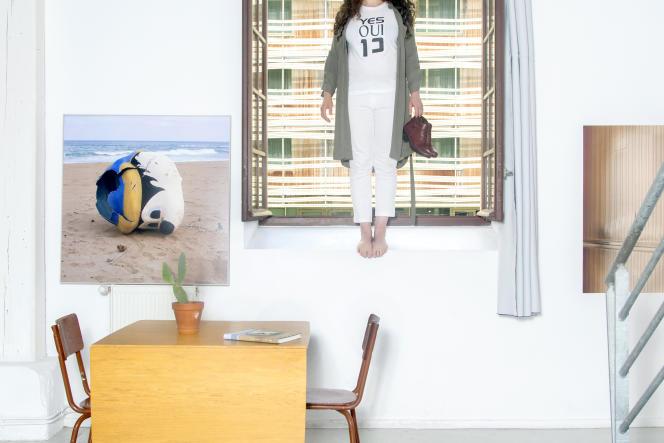 La photographe Tami Notsani, dans son atelier, quai de la Loire,à Paris (19e), le 12juillet 2021.