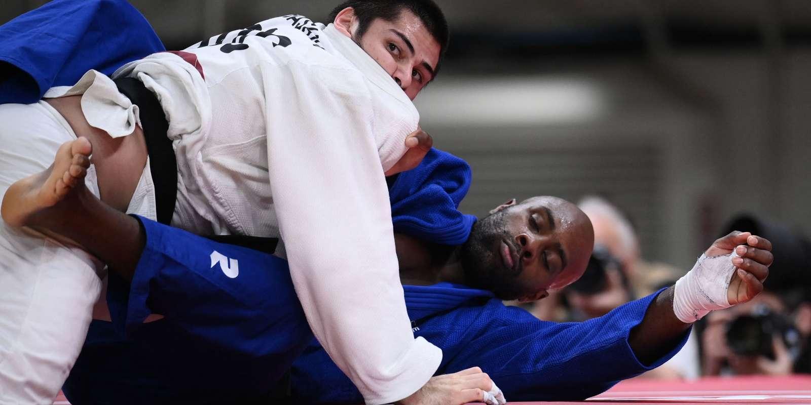 Le Français Teddy Riner et le Russe Tamerlan Bashaev s'affrontent en quart de finale de judo hommes +100kg lors des Jeux olympiques de Tokyo, le 30juillet2021.
