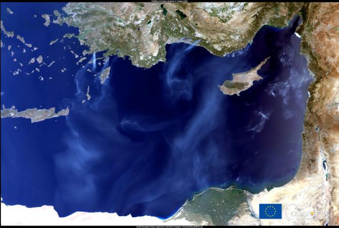A satellite image sent by the European Union shows smoke spreading in several municipalities in Turkey on August 1, 2021.