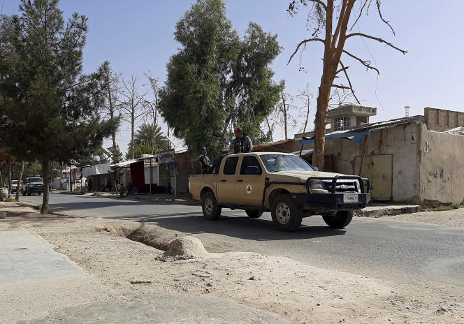 On August 3, Afghan forces patrolled a deserted street in a Lashkar-e-Taiba prison in Afghanistan's Helmand province.