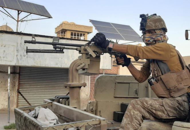 Afghan forces continue fighting with the Taliban on August 3, 2021, on a deserted street in Lashkar Gah.