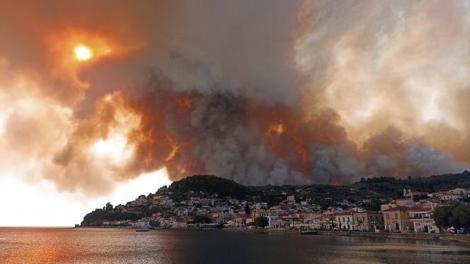 North of Athens Tuesday, August 3, 2021, smog in the mountains of the island of Evia.