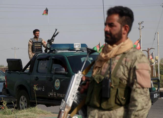 Afghan security forces monitor a checkpoint in Herat province on July 9, 2021.