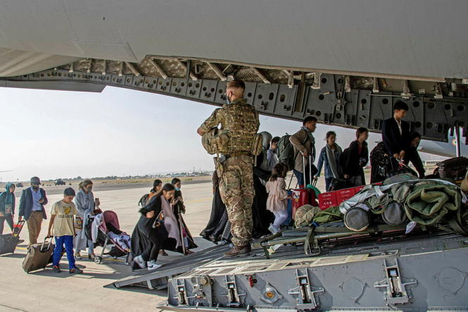 British and dual nationals living in Afghanistan boarded a military plane in Kabul on August 16, 2021.