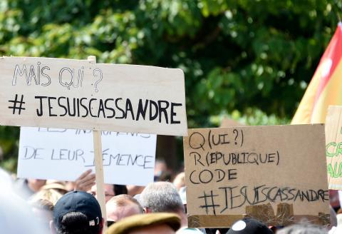 Demonstrators holds up placards that read, '#I am Cassandre', refering to Cassandre Fristot who was arrested for her antisemitic sign during the demonstration on August 7, during a national day of protest against the compulsory Covid-19 vaccination for certain workers and the compulsory use of the health pass called for by the French government in Metz on August 14, 2021. (Photo by JEAN-CHRISTOPHE VERHAEGEN / AFP)