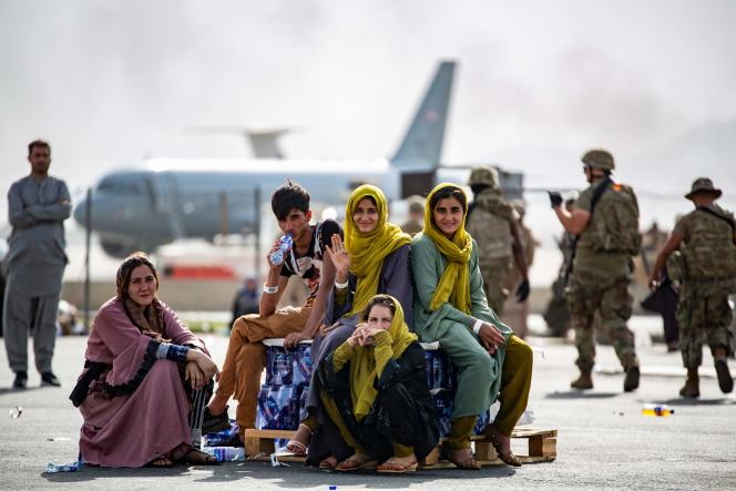 Children are waiting to be evacuated at Kabul Airport on August 19, 2021.