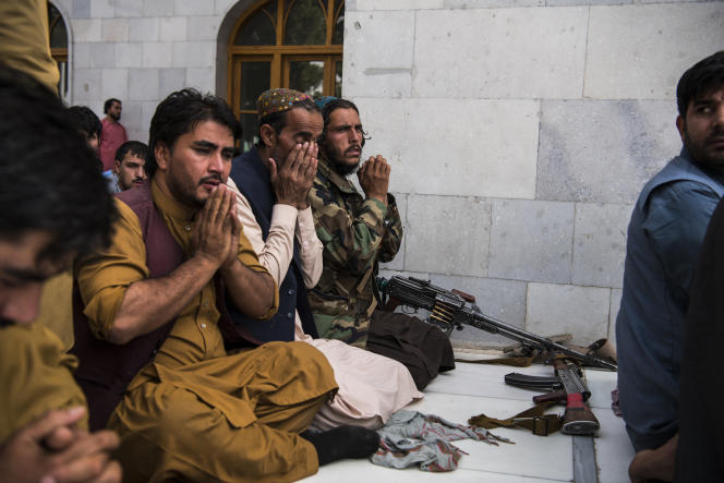 A Taliban prays among worshipers at the Pul-e-Kheshti mosque in central Kabul on August 15, 2021.