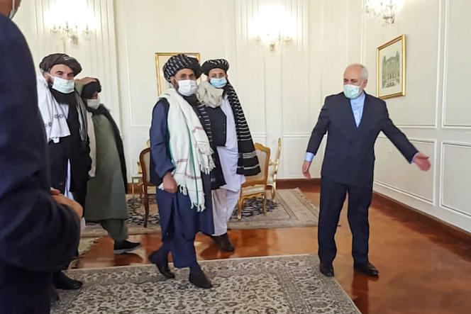 Mohamed Jawad Sharif receives the then Iranian Foreign Minister (right), Mullah Abdul Ghani Bardar (center) and the Taliban delegation to Tehran on January 21, 2021.